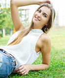 Woman sitting in a green park Royalty Free Stock Photo