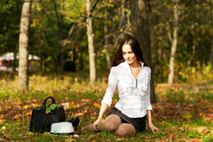 Woman sitting on the ground Stock Photo
