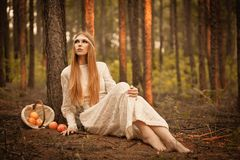 Woman sitting on  ground in the forest Stock Photos