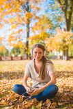 Woman Sitting on Ground Listening Music Ipod Stock Photos