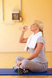 Woman sitting in gym Royalty Free Stock Images