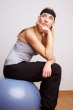 Woman sitting on gym ball Royalty Free Stock Image