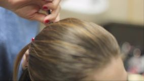 Woman sitting at the hairdresser stock video