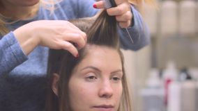 Woman sitting at the hairdresser stock footage