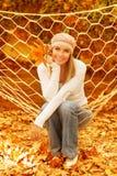 Woman sitting in hammock Stock Image