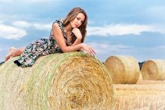 Woman  sitting on hay bale Royalty Free Stock Photo