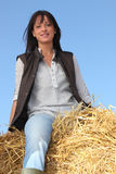 Woman sitting on hay Royalty Free Stock Photo