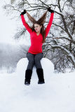 Woman sitting on the heart of the snow Royalty Free Stock Photos