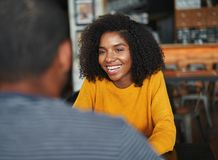 Woman sitting with her boyfriend in cafe stock images