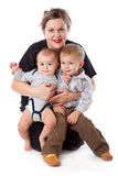 A woman is sitting with her children Royalty Free Stock Photography