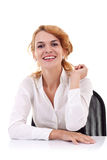 Woman sitting at her desk Royalty Free Stock Images