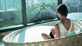 Woman sitting at her luxury home stock footage