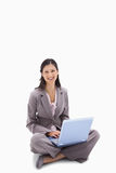 Woman sitting with her notebook Stock Images