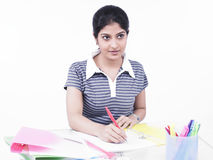 Woman sitting at her office desk. Young woman sitting at her office desk Royalty Free Stock Images