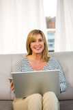 Woman sitting on her sofa Royalty Free Stock Images