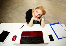 Woman sitting at her work place Royalty Free Stock Images