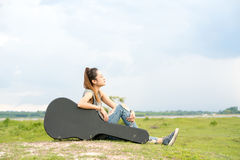 Woman sitting on the hill see forward  the blue sky Royalty Free Stock Image
