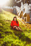 Woman sitting on hill at sunny autumn day Royalty Free Stock Photos