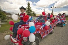 Woman sitting on the hood of a jeep decorated for the Fourth of July, in Lima Montana Royalty Free Stock Photos