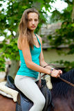 Woman sitting on horse Royalty Free Stock Images