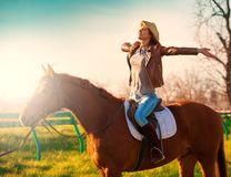 Woman sitting  horse. Sunset. Stock Images