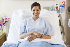 Woman Sitting In Hospital Bed Stock Photo