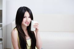 Woman sitting with hot milk Stock Image