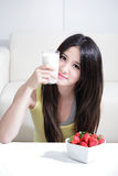 Woman sitting with hot milk Royalty Free Stock Images