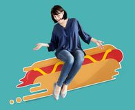 Woman sitting on an illustrated hot dog Stock Photos