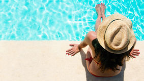 Woman Sitting In A Swimming Pool Royalty Free Stock Photo