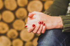 Woman sitting indoors with her hands crossed Royalty Free Stock Photo
