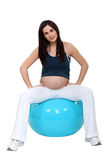 Woman sitting on inflatable balloon Royalty Free Stock Photo