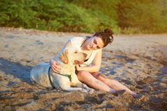 Woman sitting with labrador dog Stock Images