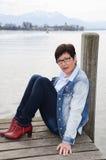 Woman sitting at Lake Chiemsee Stock Photos