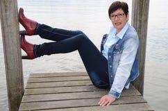 Woman sitting at Lake Chiemsee Royalty Free Stock Images