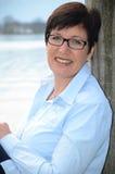 Woman sitting at Lake Chiemsee Stock Photography