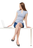 Woman sitting with a laptop Stock Image