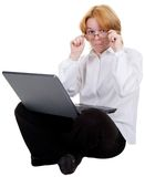 Woman sitting with the laptop Stock Photography