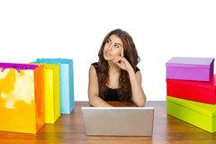 Woman sitting on laptop shopping Royalty Free Stock Image