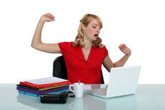 Woman sitting at a laptop stock image