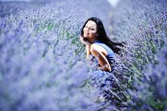 Woman sitting on a lavender field Stock Image
