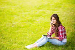 Woman sitting on the lawn Royalty Free Stock Photo