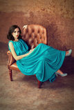 Woman sitting at leather armchair Royalty Free Stock Photo