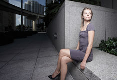 Woman sitting with legs crossed Royalty Free Stock Photo