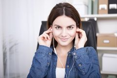 Woman sitting listening to music or a recording Royalty Free Stock Photos
