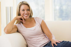 Woman sitting in living room Royalty Free Stock Photos