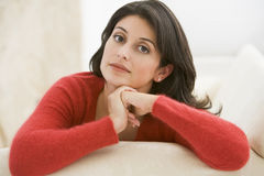 Woman sitting in living room Stock Image