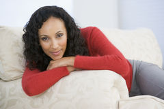 Woman sitting in living room Stock Images