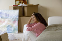 Woman sitting in livingroom of new home Royalty Free Stock Photos