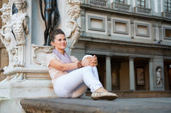 Woman sitting in loggia dei lanzi in florence Stock Photo